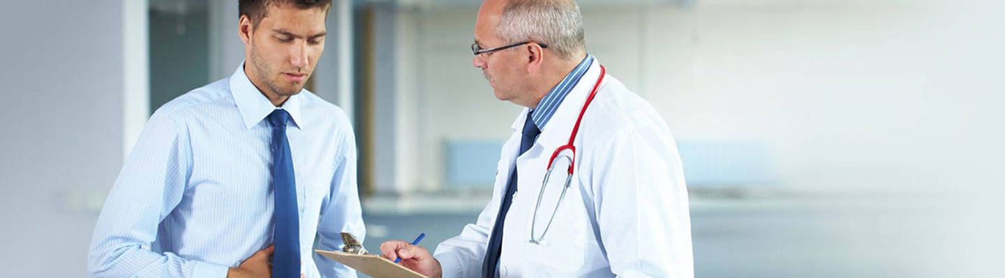 A patient visits with a gastroenterologist.