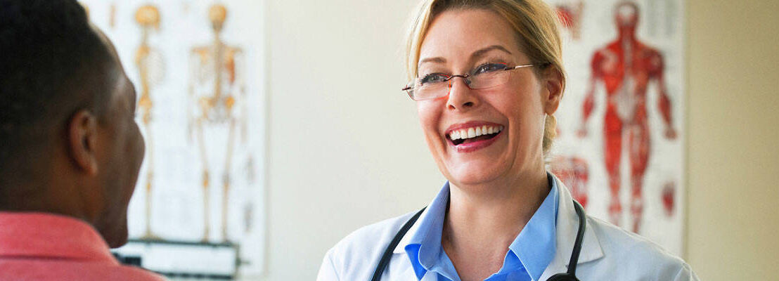 Doctor laughing with an adult patient