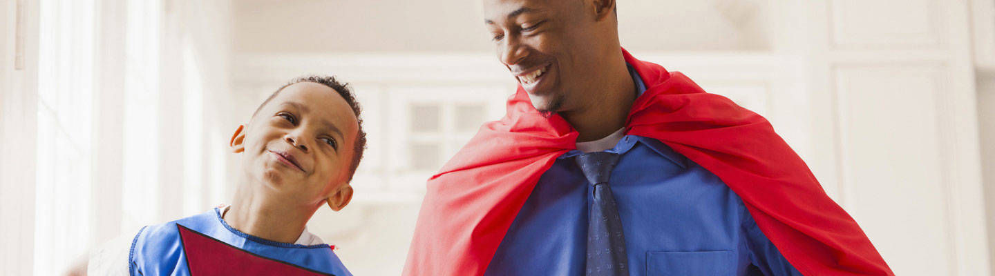 Father and son dressed as super heros