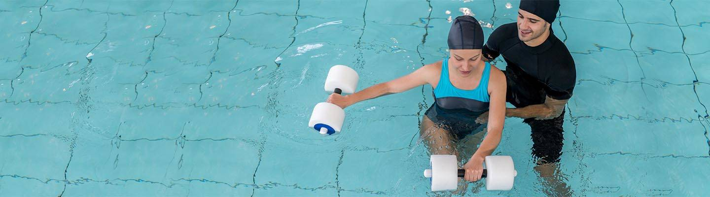 Woman doing physical therapy in the swimming pool