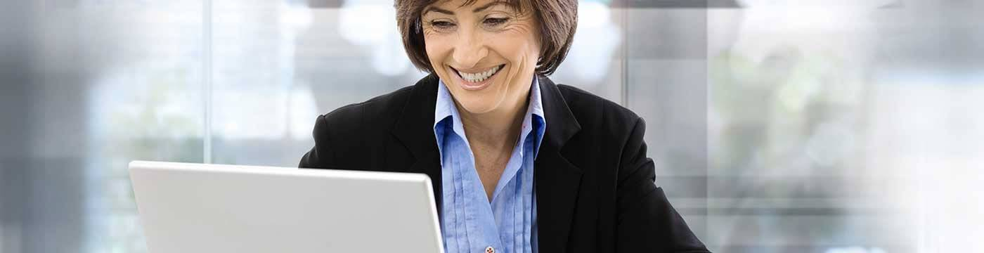 Woman with laptop smiling