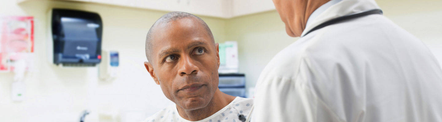 Male patient consulting with male doctor