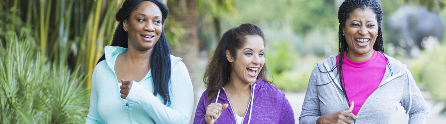 3 women jogging and smiling